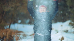 Child teen boy throws snow up. Fountain of snow 014 Stock Footage