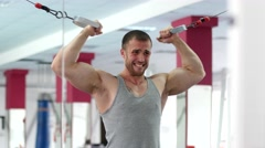 Young muscular man hard training in gym Stock Footage