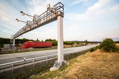 Truck passing through a toll gate on a highway (motion blurred i Stock Photos