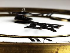 Old clock with roman numerals. - stock photo