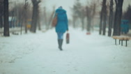 Stock Video Footage of snow-covered streets. People in the snowfall 001