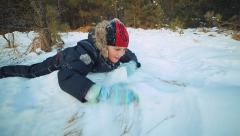 Snow fun. Teenager crawling in the snow Stock Footage