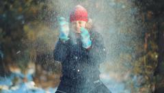 Child throws snow up. Fountain of snow Stock Footage