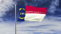 North carolina flag with title waving in the wind. Looping sun rises style Stock Footage