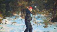 Stock Video Footage of Boy throws snow up. Fountain of snow. Snow falls on a child's face