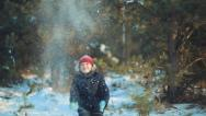 Stock Video Footage of Snow fun. Child throws snow up 011