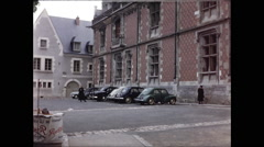 Wide Shot of Building with Cars Parked Stock Footage