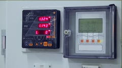 Digital indicators of a control cabinet at electrical substation - stock footage