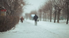 Snow-covered streets. People in the snowfall Stock Footage