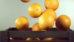 Ripe orange and box Stock Footage