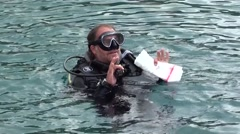 Diver in water with plastic bag for collecting of garbage Stock Footage