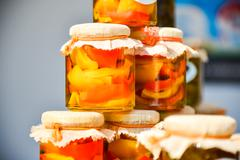 Home Canned Peppers in jars - stock photo