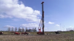 Construction site with piledriving machine along highway Stock Footage