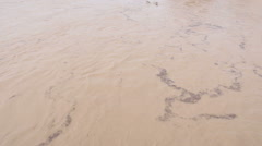 Overflown river with mud and debris - stock footage