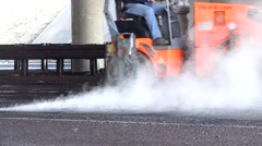 Road Construction, raking and rolling , steam roller - stock footage