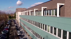 Aerial shot of a modern office building in Europe - Establishing Shot  Stock Footage