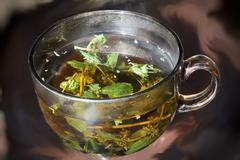 Mint tea cup taken closeup. - stock photo