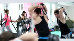 Young muscular men hard training in gym Stock Footage