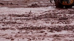 grader on a flood road - stock footage
