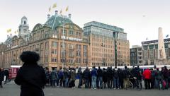 Crowd Gathered Around In City Open Area Stock Footage