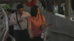 People Walking on overpass & BTS Skytrain at Chong Nonsi BTS Station Stock Footage