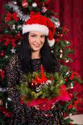 Woman holding Christmas arrangement Stock Photos