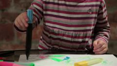 Little girl painting with colorful felt pen on white paper. Kid, child, tilt up. Stock Footage