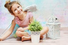 Little witch with charming smile - stock photo