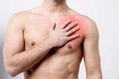 Man having chest pain, heart attack. - stock photo