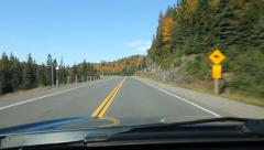 Sunny autumn drive in Northern Ontario. Corner with signs. Stock Footage
