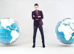 Young businessman and Earth globe Stock Photos