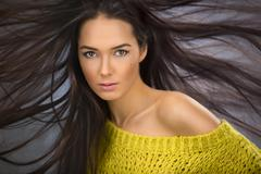 Portrait of a charming sexy brunette with long flowing hair wind Stock Photos