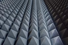 Texture soundproof panels in perspective. Triangles of the same Stock Photos