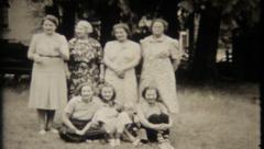 1927 - family poses for photo, grandpa runs around - vintage film home movie Stock Footage