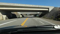Driving under highway bridges. Hwy 518 near Parry Sound, Ontario, Canada. Stock Footage