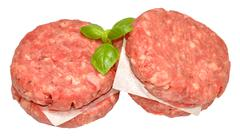 Raw Quarter Pound Beef Burgers - stock photo