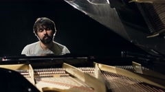 Making music. Profile of a handsome men playing piano Stock Footage