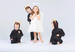 Little angel and three devils - stock photo