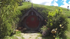 Small hobbit hole with red door Stock Footage