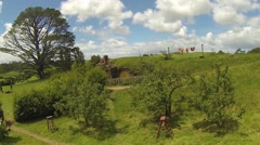 Hobbit hole with party tree in the background Stock Footage