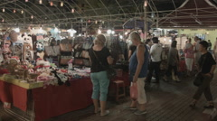 A wide shot of the tables at the Anusarn night market in Chiang Mai Thailand. Stock Footage