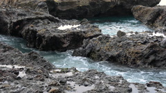 Pan of reef crevice with waves breaking - stock footage