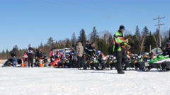 Children Getting Ready To Race Snowmobiles Stock Footage