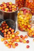 Preserving Mirabelle plums - jars of homemade fruit preserves – Mirabelle prune - stock photo