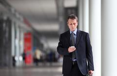 Businessman thinking law on the cell phone Stock Photos