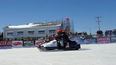 Getting Ready To Race Snowmobiles Stock Footage