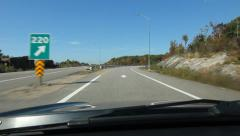 Highway exit. Leaving HWY 400 and driving on offramp. - stock footage