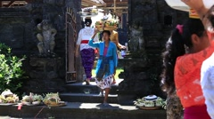 Women bring offerings of fruits and gifts to the village temple. Bali, Indonesia Stock Footage