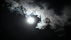 Amazing night sky with shining full moon behind moving dramatic clouds. Time lap - stock footage