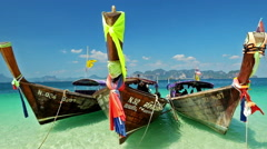 Thai traditional wooden boat at ocean shore - stock footage
